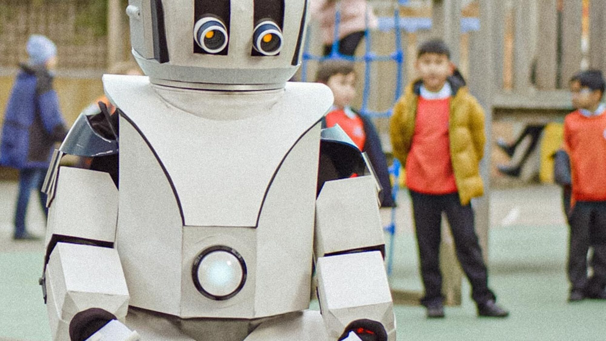 Child robot in a school playground from War Child's #EscapeRobot campaign