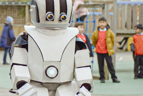 Child robot in a school playground from War Child