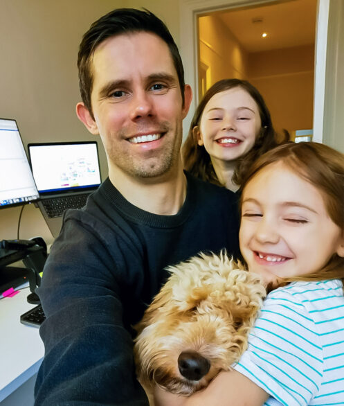 Ryan Wilkins (Founder & CEO at Raw London) working from home with his 2 children and their dog, Paddy