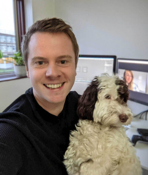Tom Fuller, Art Director at Raw London working from home with his cockerpoo, Jean-Luc