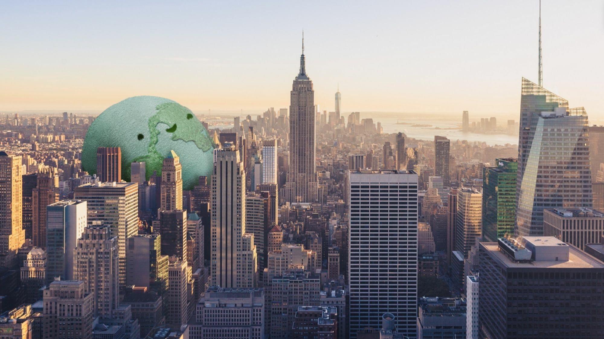 A cartoon Earth sits smiling among a city landscape